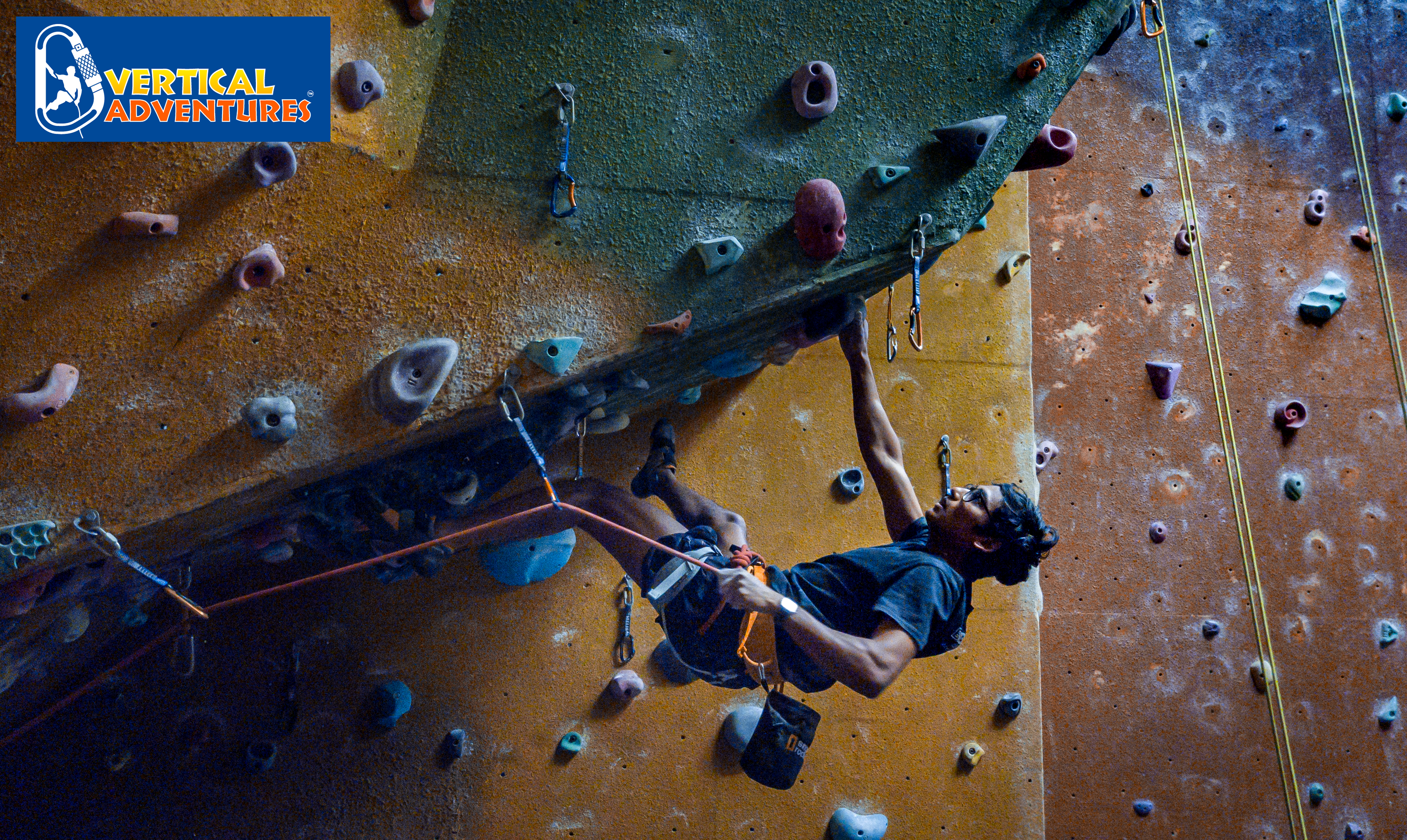 person climbing on an indoor wall at Vertical Adventures Auckland