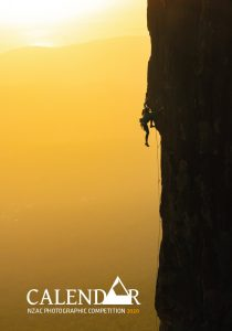 sunset image of a rock climber on a vertical rock face